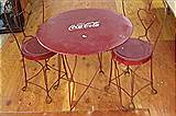 Wrought iron Child's Coca Cola table and two chairs